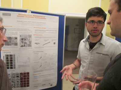 Discussing during a student poster session